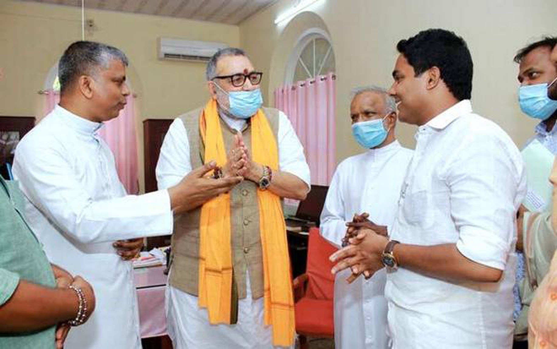 Alappuzha bishop James Anaparambil receives national BJP minister Giriraj Singh along with BJP coalition candidate Anoop Antony on the left courtey The Hindu daily