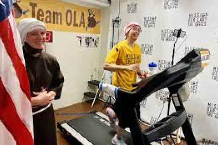 Sister Stephanie Baliga runs a marathon on a treadmill in 2020