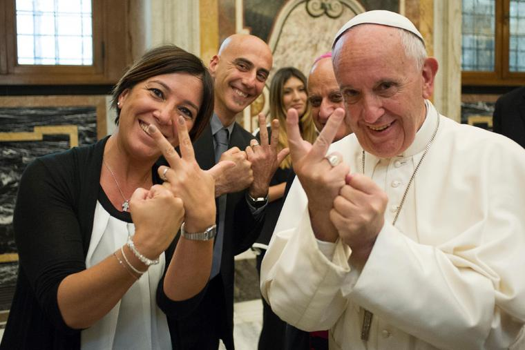 Pope Francis uses sign language with participants of the Jubilee for the sick and disabled in the Pope Paul VI Hall on June 10, 2016.