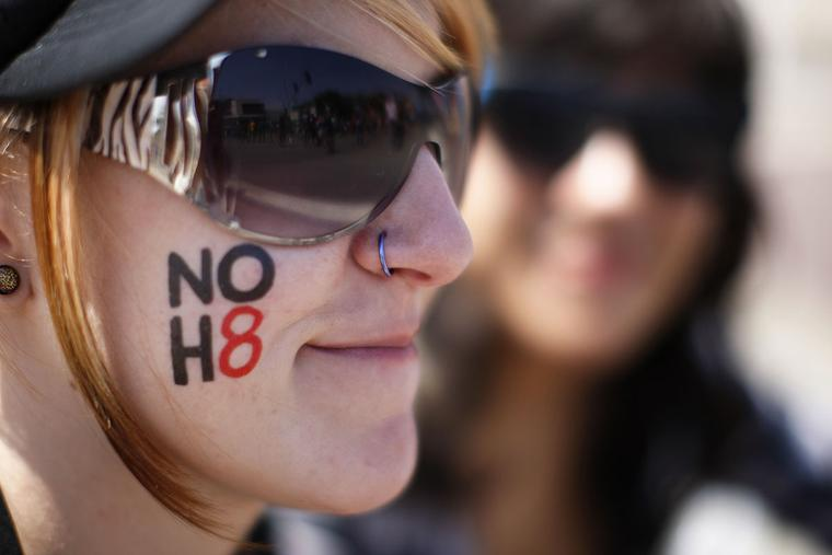 "An activist wears a ""no hate"" message on her cheek at the 43rd L.A. Pride Parade on June 9, 2013, in West Hollywood, California."