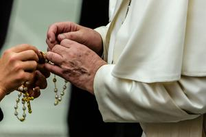 Pope Francis holds a rosary after the Wednesday general audience inside the Vatican's Paul VI Hall, Aug. 7, 2019.