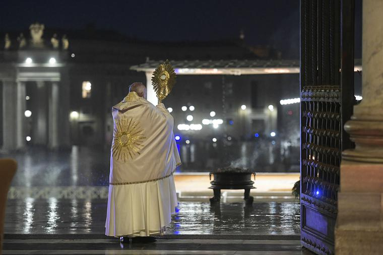 Pope Francis carries the Blessed Sacrament at the entrance of St. Peter's Basilica, during a televised holy hour with Eucharistic Adoration and an extraordinary Urbi et Orbi blessing in response to the coronavirus pandemic, March 27, 2020.