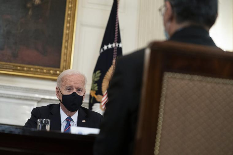 Health and Human Services Secretary Xavier Becerra listens as President Joe Biden speaks about the southern border during a meeting in the State Dining Room of the White House March 24 in Washington.