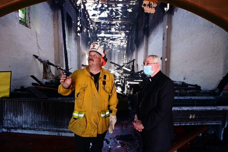 Archbishop Jose Gomez of Los Angeles visits the scene of the fire at San Gabriel mission, July 11, 2020