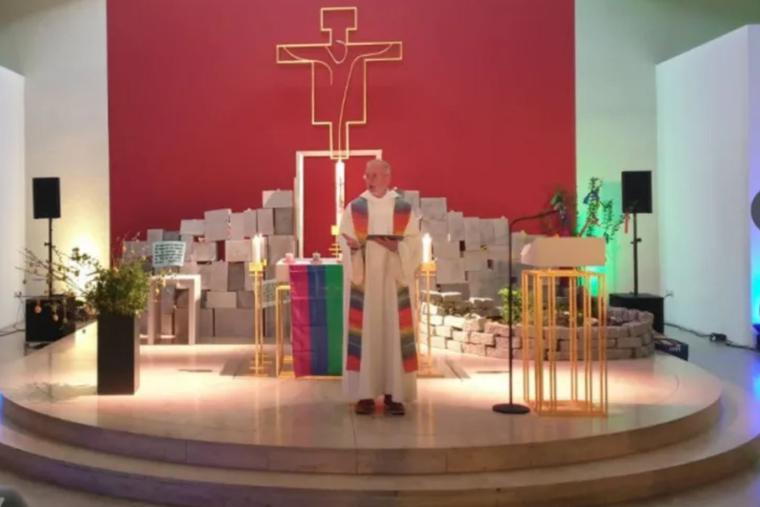 A service as part of a day of action in defiance of the Vatican's ruling on same-sex blessings takes part in the youth church in Würzburg, Germany, on May 10.