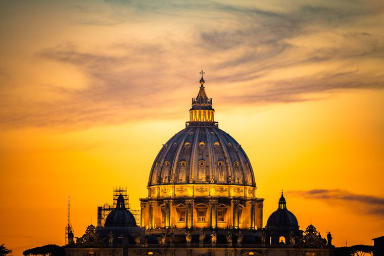 Dome of St. Peter's Basilica at sunset.