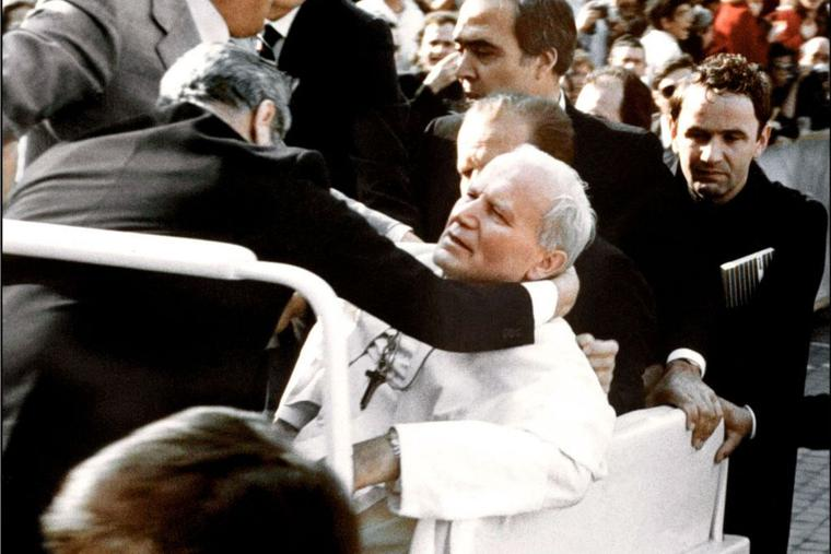 'Mary, my mother; Mary, my mother.' Bodyguards hold Pope John Paul II after he was shot May 13, 1981, in St. Peter's Square by Turkish gunman Mehmet Ali Agca. After he was shot, the Pope appealed to the intercession of the Blessed Mother. Agca was jailed for 19 years in Italy for the attack on the Pope, which left the Holy Father seriously wounded. Agca was pardoned by the Italian president in June 2000 and extradited back to Turkey, where he was jailed for a 1979 murder.