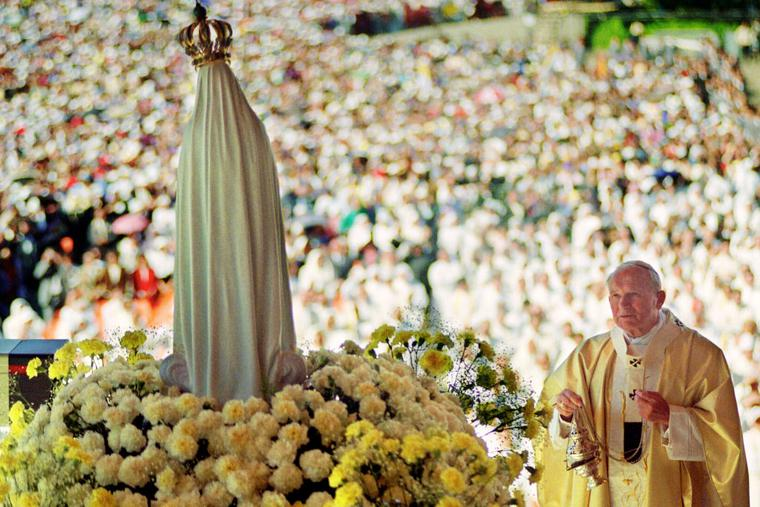 Pope John Paul II celebrates a mass May 12, 1991 in the Chapel of the Apparition in front of the statue of Virgin of Fatima in Fatima where about a million believers attended the Procession of Candles. In 1997, the pope dedicated a shrine in a Polish church to the Virgin of Fatima, thanking her for intervening to save him from an assassination attempt in 1981.
