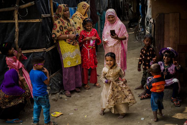 Rohingya Muslim refugees gather during the Eid al-Fitr holiday inside their temporary settlement on May 14, 2021 in New Delhi, India. A lockdown is in effect as COVID-19 cases have surged in India, causing a shortage of oxygen supplies across the country.