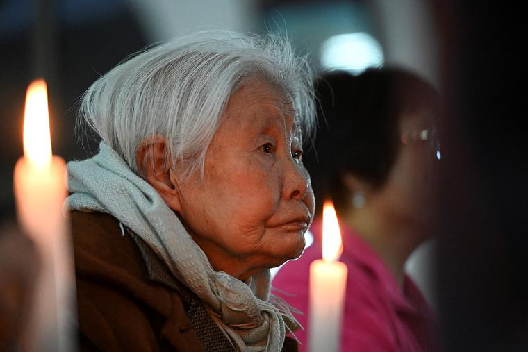 Chinese Catholics attend Easter Vigil Mass near Beijing on April 3.