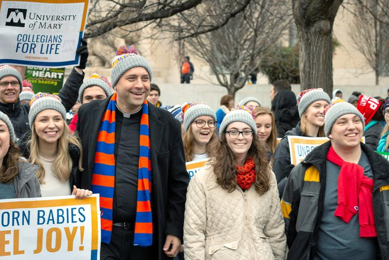 Msgr. James Shea and students from the University of Mary participate in the 2020 March for Life in Washington, DC.