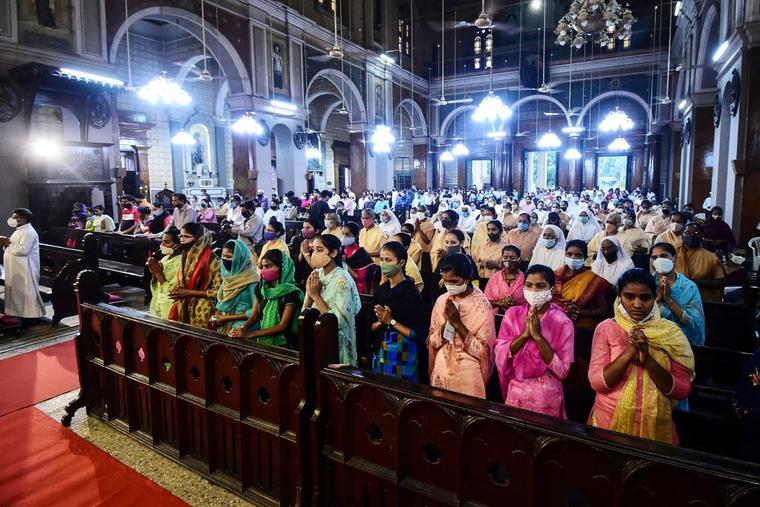 Catholics gather for prayer during Mass at St. Joseph's Cathedral on the eve of Good Friday in Allahabad on April 1.