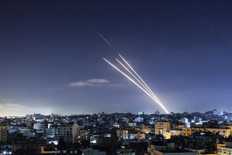 Rockets are launched toward Israel from Gaza City, controlled by the Palestinian Hamas movement, on May 18. Heavy air strikes and rocket fire in the Israel-Gaza conflict claimed more lives on both sides as tensions flared.