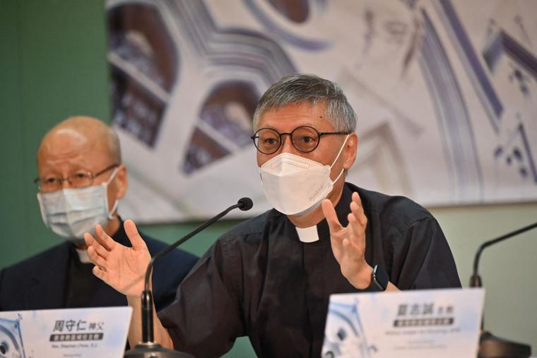 Newly appointed Bishop of Hong Kong Rev. Stephen Chow (R) speaks at a press conference with Cardinal John Tong (L) in Hong Kong on May 18, 2021.