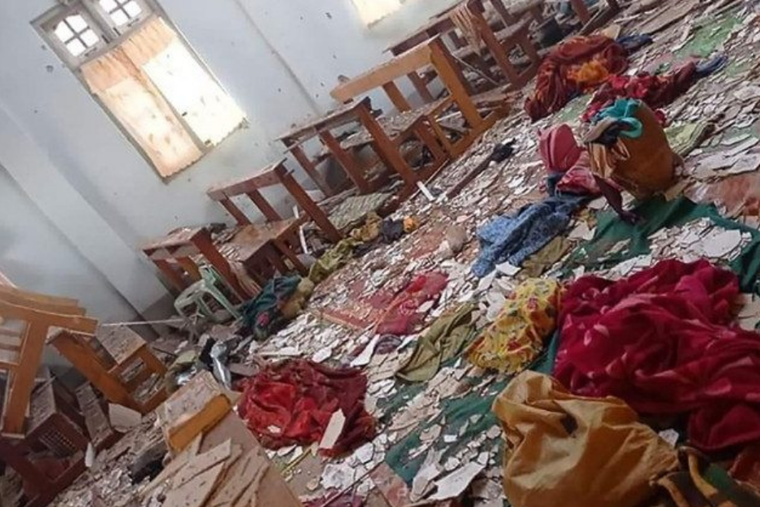 The roof and ceiling of Sacred Heart Church were damaged by the military attack on May 24.