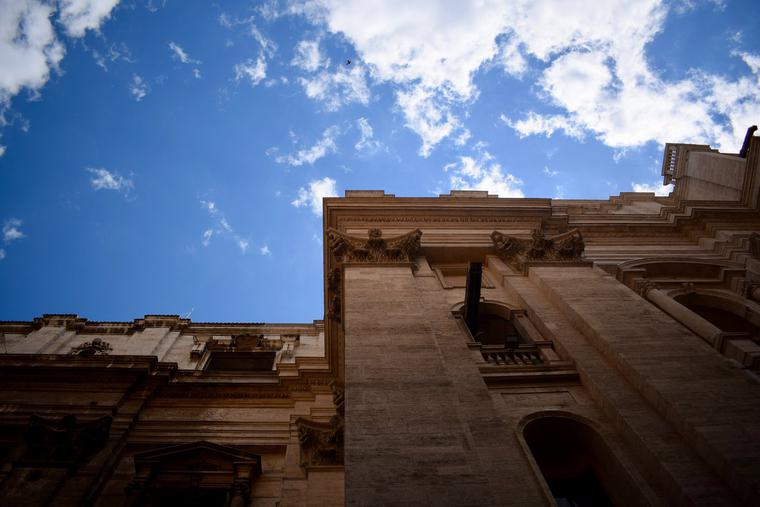 A view of St. Peter's Basilica shows the façade and the sky.