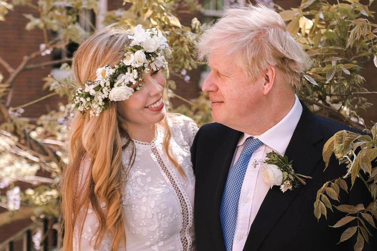Prime Minister Boris Johnson poses with his wife Carrie Johnson in the garden of 10 Downing Street following their wedding at Westminster Cathedral, May 29, 2021 in London, England.