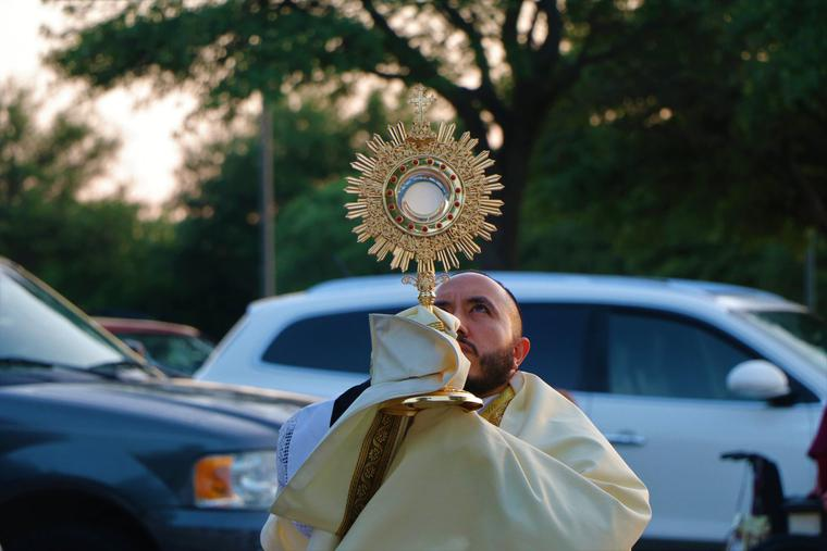 Outdoor adoration takes place during the COVID-19 pandemic in Richardson, Texas.