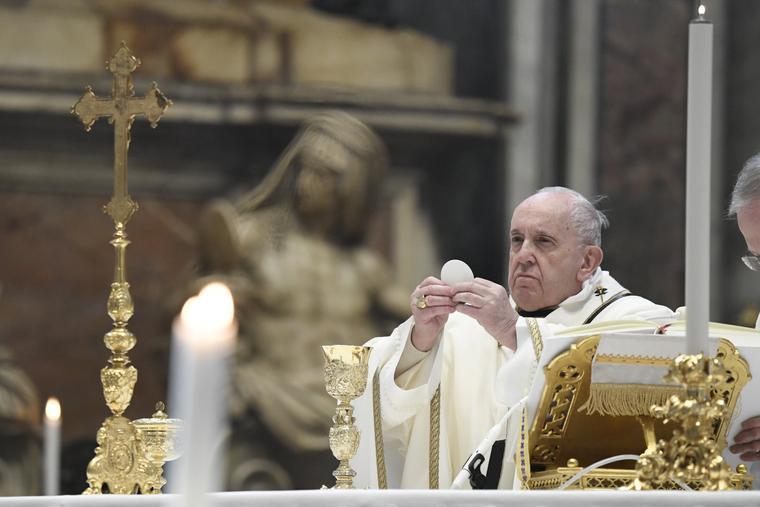 Above, Pope Francis celebrates Mass on Jan. 6. His June 6 Angelus address on Corpus Christi Sunday focused on the Eucharist, 'the greatest sacrament.'