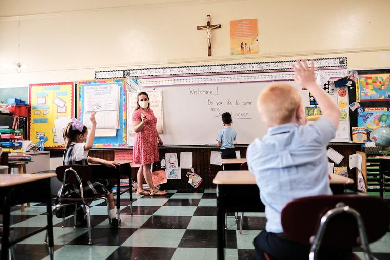 A teacher asks students questions during class at a Boston archdiocese school amid the coronavirus pandemic.