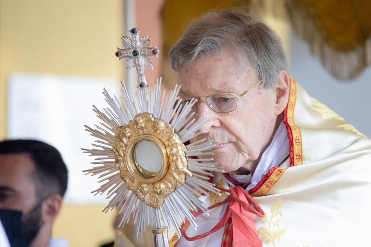 Cardinal George Pell holds the monstrance with the Blessed Sacrament during the annual Eucharistic procession at the Angelicum in Rome on May 13.