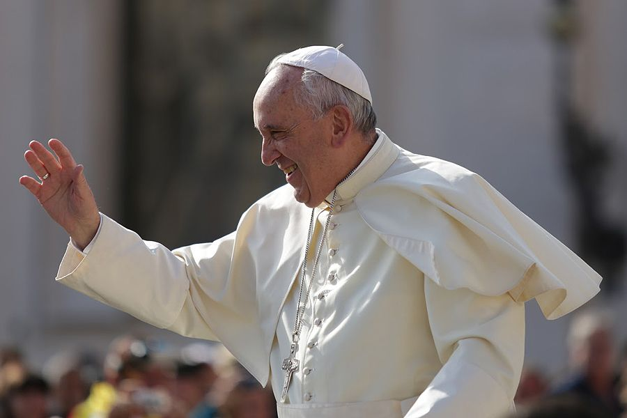 Pope Francis waves to pilgrims in St. Peter's Square on Sept. 9, 2015 for the general audience.