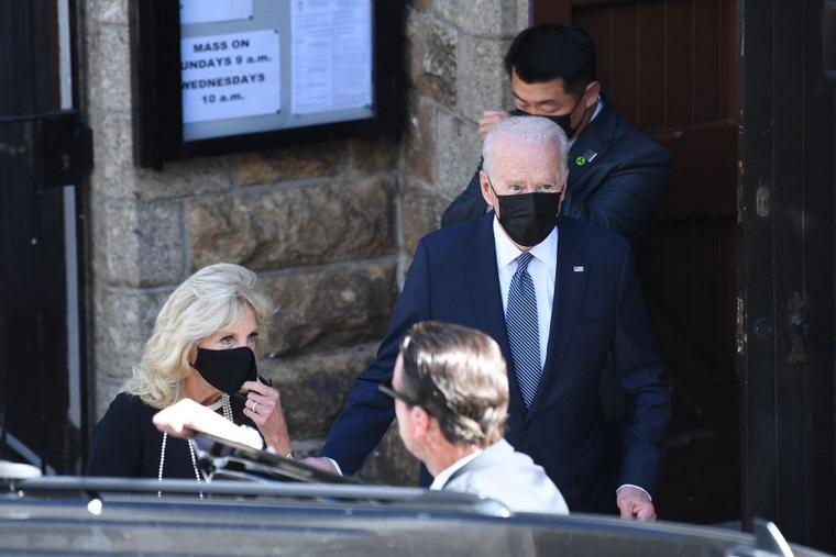 President Joe Biden and First Lady Jill Biden leave Mass in St Ives, Cornwall during the G7 summit on June 13, 2021.