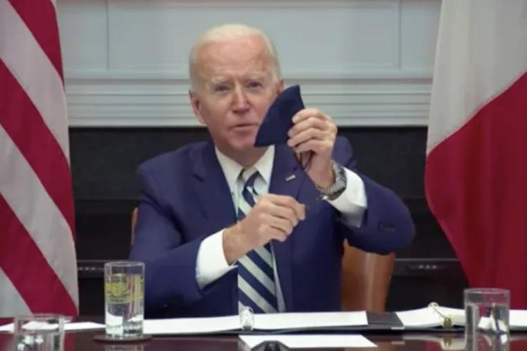 President Joe Biden reveals his rosary beads during a March 1 virtual meeting with Mexican President Andrés Manuel López Obrador.