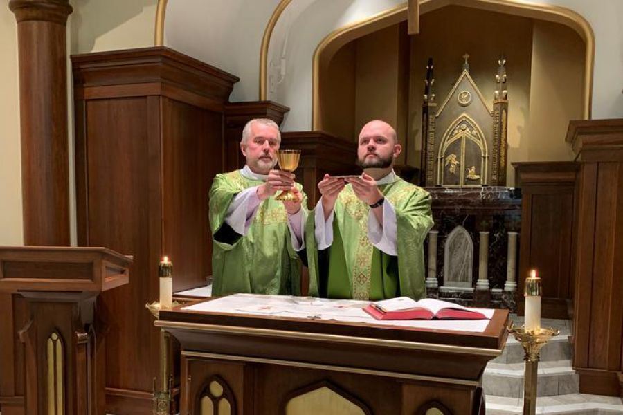 Father Eric Seitz says Mass, with his father, Deacon Ben Seitz, assisting as deacon.