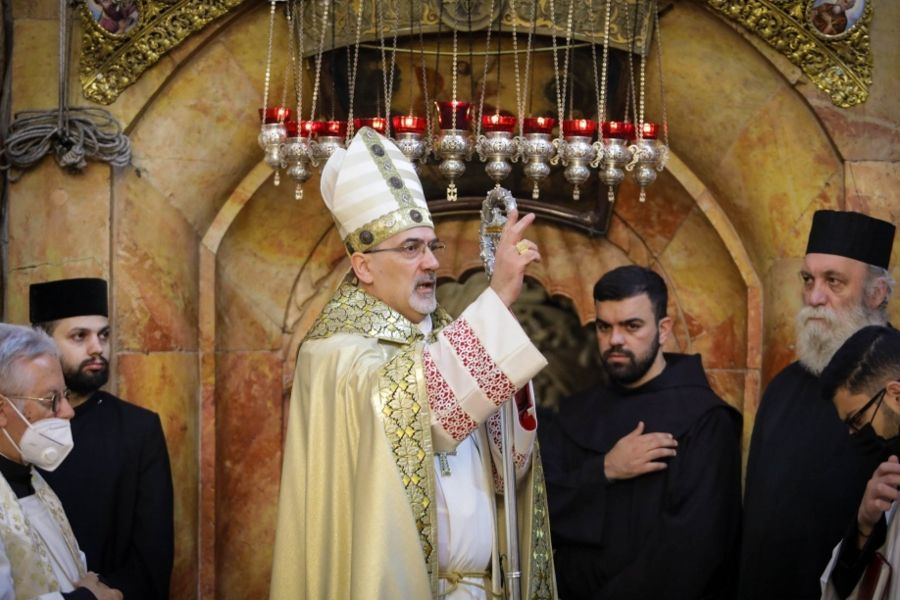 Patriarch Pierbattista Pizzaballa blesses the congregation at the Church of the Holy Sepulchre in Jerusalem on April 4, 2021.