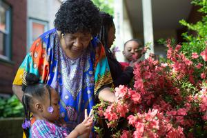 Sharonell Fulton has fostered more than 40 children. She plants a tree or rose bush in her front yard with her foster children as a symbol of their growth.