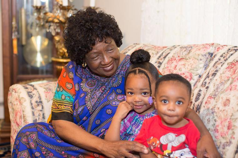 Philadelphia foster mom Sharonell Fulton alongside two of her foster children.