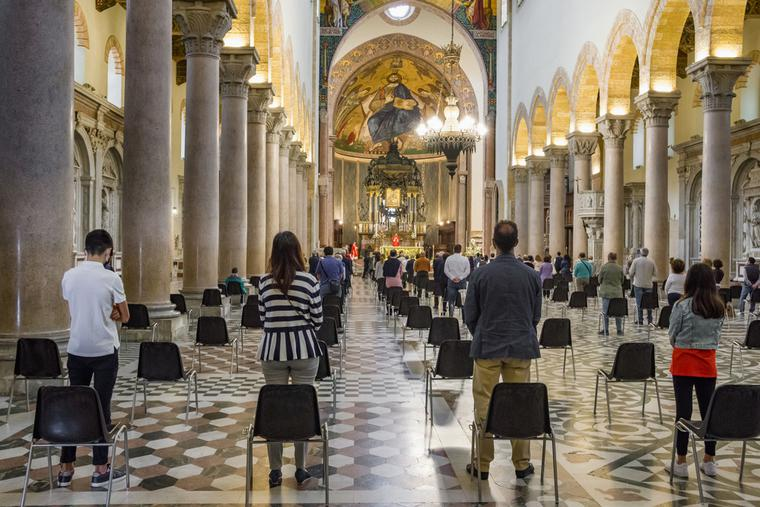 Catholics attend Mass amid the COVID pandemic.