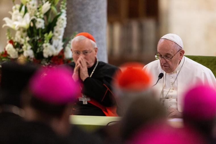 """Cardinal Gualtiero Bassetti, president of the Italian Episcopal Conference, (L) listens while Pope Francis addressed bishops from 19 Mediterranean countries on the final day of a meeting entitled """"Mediterranean frontier of peace"""" in Bari, Italy, Jan. 22, 2020."""