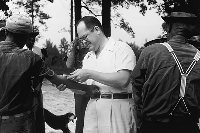 A researcher draws blood from participants in the Tuskegee experiment.