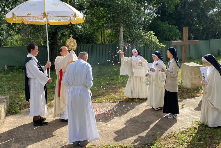 Father John Rizzo leads a Eucharistic procession with the Tyburn Nuns in Parramatta, Australia.