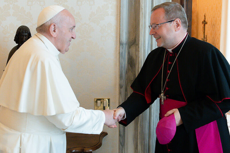 Pope Francis greets Bishop Georg Bätzing for a private audience at the Vatican on July 24, 2021.