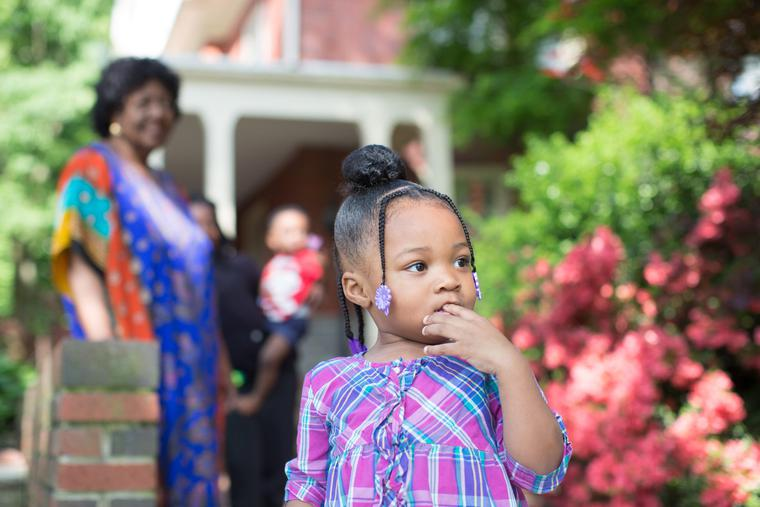 A young girl looks out as her foster mother, Sharonell Fulton, watches her from a distance in Philadelphia, Pa.