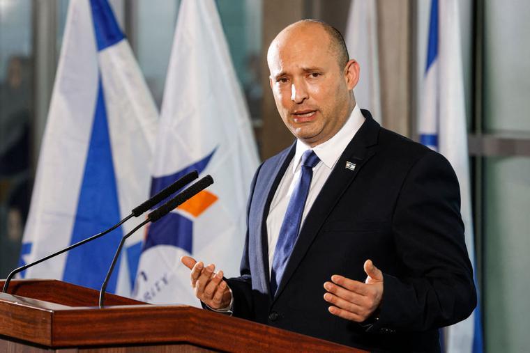New Israeli Prime Minister Naftali Bennett addresses reporters at Ben Gurion International Airport on June 22.