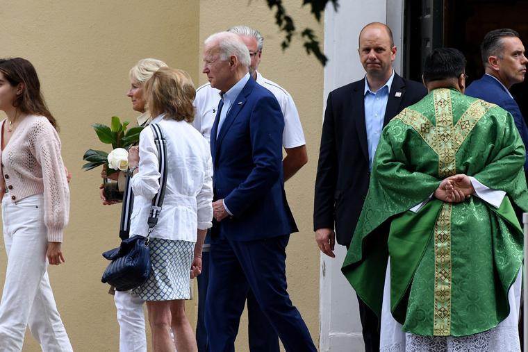 President Joe Biden (C) and First Lady Jill Biden (2nd L) leave St. Joseph on the Brandywine Catholic Church in Wilmington, Delaware, June 19, 2021.