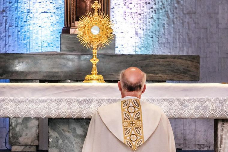 Archbishop Salvatore Cordileone prays before the Blessed Sacrament in the monstrance in Eucharistic adoration in 2021.