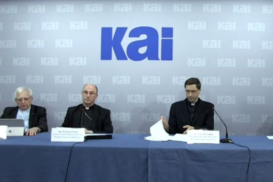 Archbishop Polak, center, at a press conference presenting a report on clerical abuse in Poland, June 28, 2021.