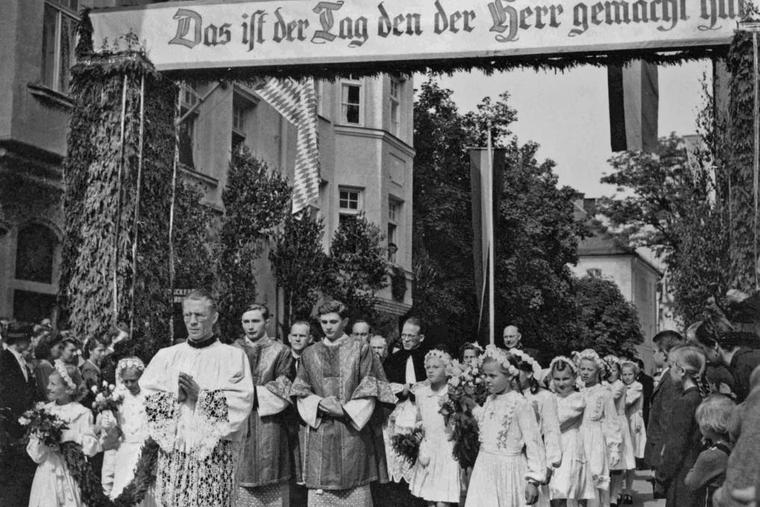 Georg (left) and Joseph Ratzinger shortly after their ordination during their first Mass processional in their then-hometown of Traunstein in 1951.