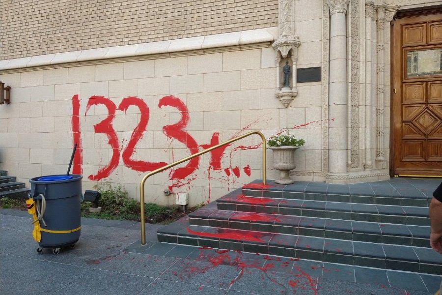 Graffiti on wall of Holy Ghost Catholic Church, Denver, Colorado