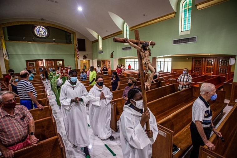 Church members pray for their neighbors during a Mass at St. Joseph Catholic Church on June 27 in Surfside, Florida. Parishioners are among the dead and missing.