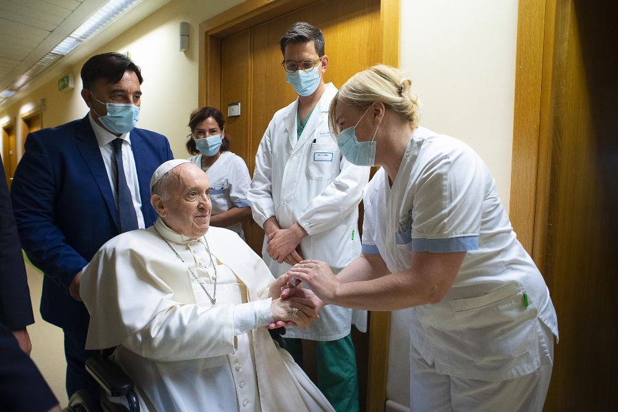 Pope Francis greets staff at the Gemelli Hospital in Rome, July 11, 2021.