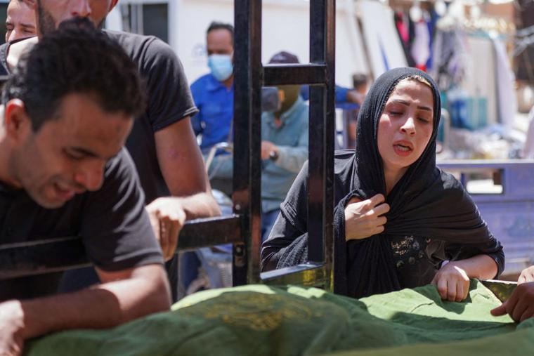 Iraqis mourn relatives who died in a massive fire which engulfed a coronavirus isolation ward of Al-Hussein hospital in the southern Iraqi city of Nasiriyah, during their funeral in the central city of Najaf, on July 13, 2021.
