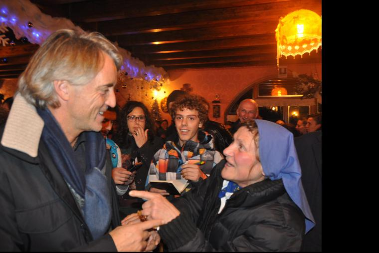 Roberto Mancini, manager for Italy's European Championship-winning team, meets Sister Rosalina Rovasio in 2019.