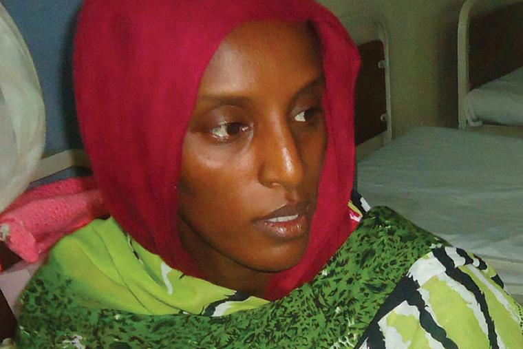 Meriam Yahia Ibrahim Ishag, a Christian Sudanese woman sentenced to hang for apostasy, sits in her cell a day after she gave birth to a baby girl at a women's prison in Khartoum's twin city of Omdurman on May 28, 2014.