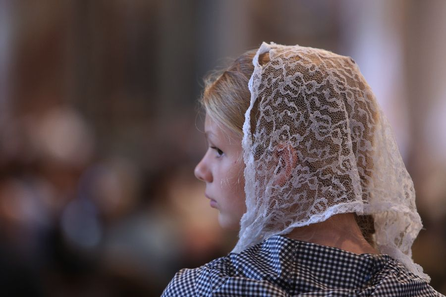 A girl with a chapel veil at the Summorum Pontificum Pilgrimage Mass in Rome on Oct. 25, 2014.